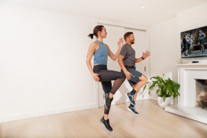 Image of a man and woman participating in Les Mills Online Class